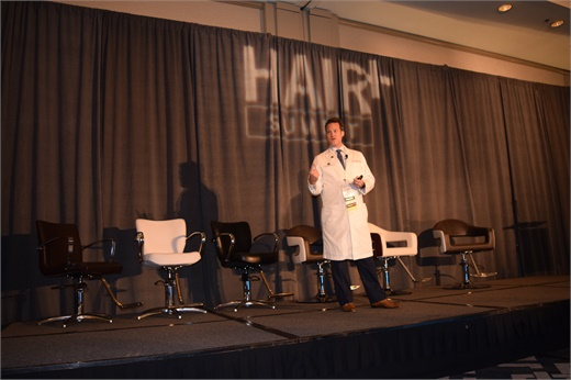 Dr. Alan Bauman of Bauman Medical walks attendees through the latest technological innovations in medical and surgical hair loss solutions.
