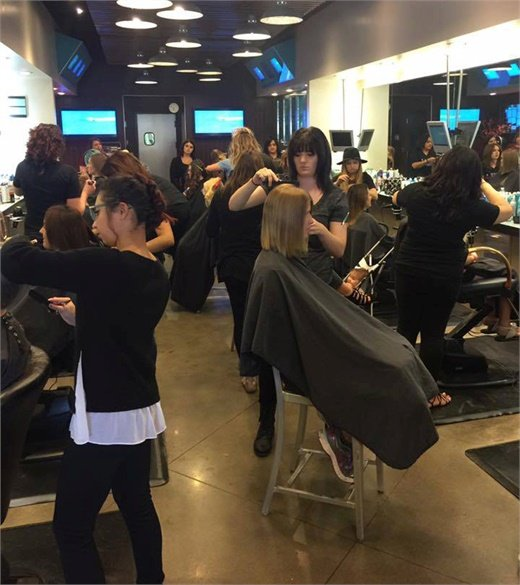 The team from Eric Fisher Salon rocking it at the Empowering Women Cut-a-thon in Wichita, Kansas.