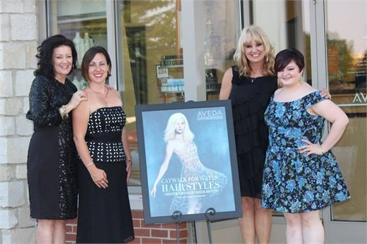 The team from Five Senses Spa and Salon in Peoria, IL, all dressed up for Catwalk for Water.