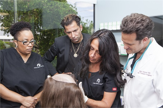 Martino Cartier of Martino Cartier Salon, second from right, with Dr. Alan Bauman of Bauman Medical Group, far right.