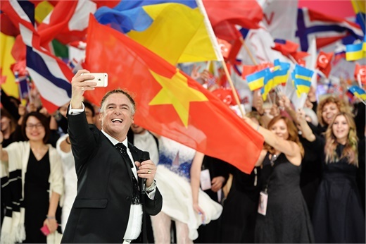 Master Of Ceremonies Patrick Cameron takes a selfie during the Parade Of Nations at ITVA 2016.