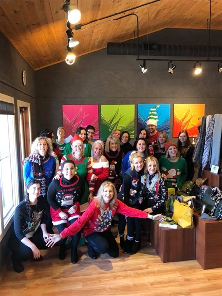 Sporting the ugly holiday sweaters, the team from Impressions in Mequon, Wisconsin.