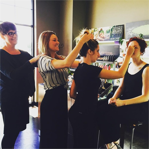 Team members at Joli Salon and Spa in Lexington, KY, using their talents to support each other.