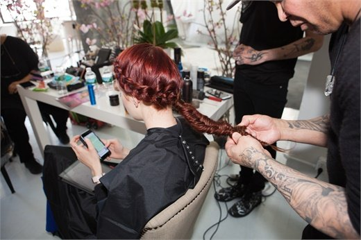 With the remaining hair, create a herringbone braid and secure with a elastic at the ends. Pull at the edges of the braid to create a tethered and voluminous look.