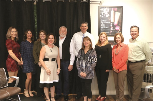Congressman Darin LaHood (center in tie) hosts a community roundtable with salon owners and industry professionals to discuss the implications of legislation for a tip tax credit.
