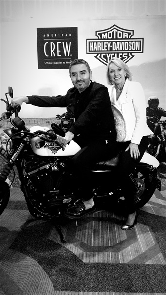 A Harley Davidson step and repeat photo area will be part of the #Style for the Road event on Dec. 1. L to r: Bellus Academy creative director Emanuel San Martin and owner Lynelle Lynch.