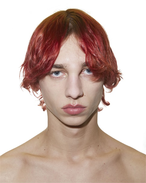 RAF SIMONS: Edgy, matte finish from Redken Global Creative Director Guido Palau.