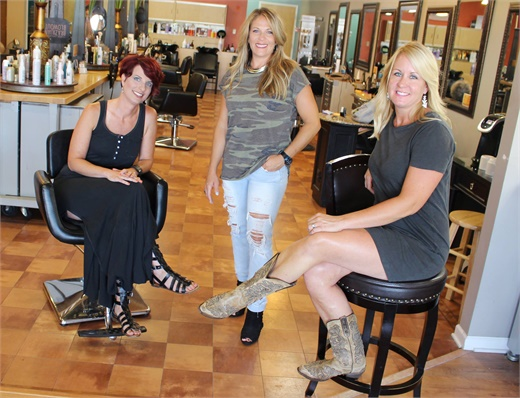 The management team from Salon Rootz in Medina, Ohio,