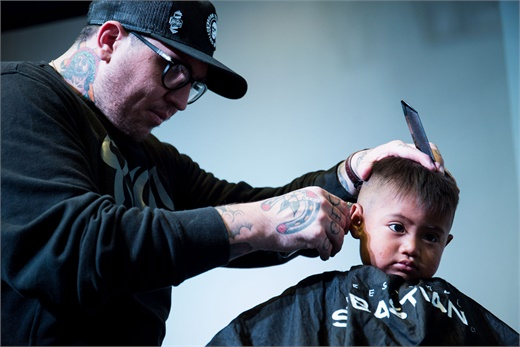 Spanky Caudill cuts a child's hair in Guatemala.