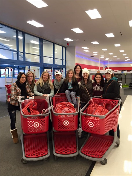 Team members from Taj Salon and Spa in Brooklyn Park, MN, shop at Target for the Adopt a Family program.