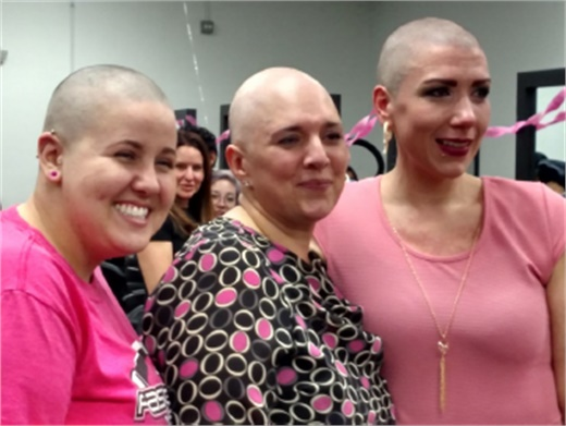 At Tricoci University of Beauty Culture in Chicago, student Jennifer Clark, left, and Campus Director Kate Sampson, right, showed their solidarity with Kellie Diaz by having their heads shaved during a fundraiser for Diaz's medical expenses.