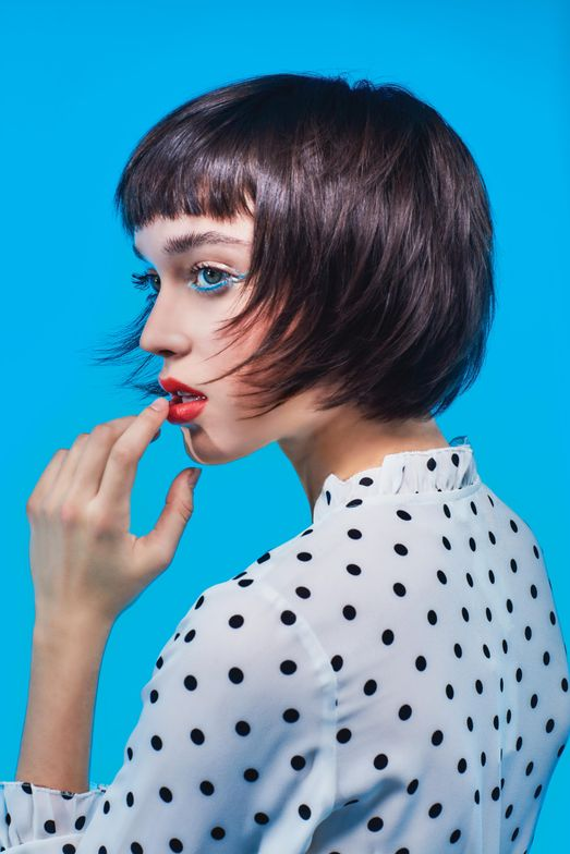 "<p>""This disconnected bob shape incorporates short bangs in connection with internal layering, creating excessive texture,"" says Rodney Cutler, Ratner Artistic Director. ""We styled to create a new perspective— sort of a quirky doll-like look by juxtaposing the curls with straight bangs.""</p> <p>Key product used: Cibu Curl Magnet Amplifying Cream</p>"