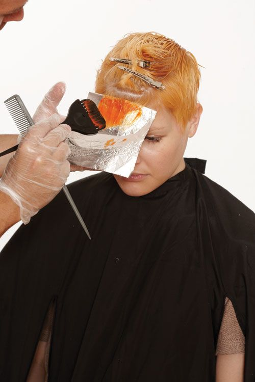 4. Apply color from mid lengths to ends. Seal the foil to protect other strands.