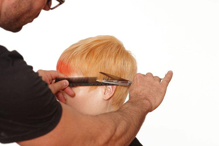 9. Soften the line below the parietal by blending using the scissor over comb technique.