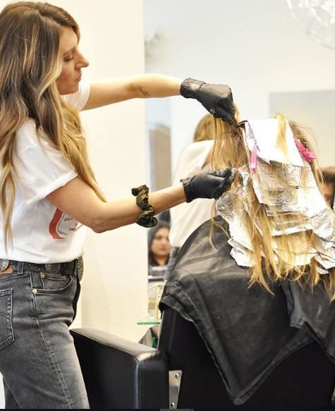 Peoria, Arizona-based colorist Michelle Zeller Porumb, @mane_ivy, works her magic in the salon.
