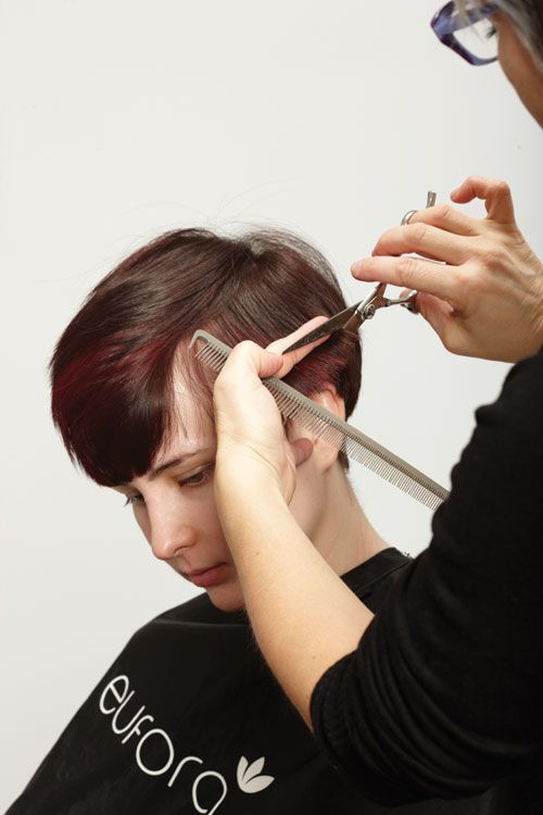 1. On dry, flatironed, smooth hair, begin the cut on the side along the parietal in the most dense area. Pull out one-inch horizontal sections. Cut to the desired length. Blend up to a top center parting.