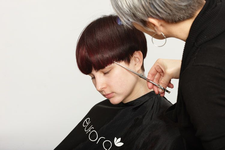 3. Brush the hair as it is to be worn. Chip into the ends of the fringe to the desired length.