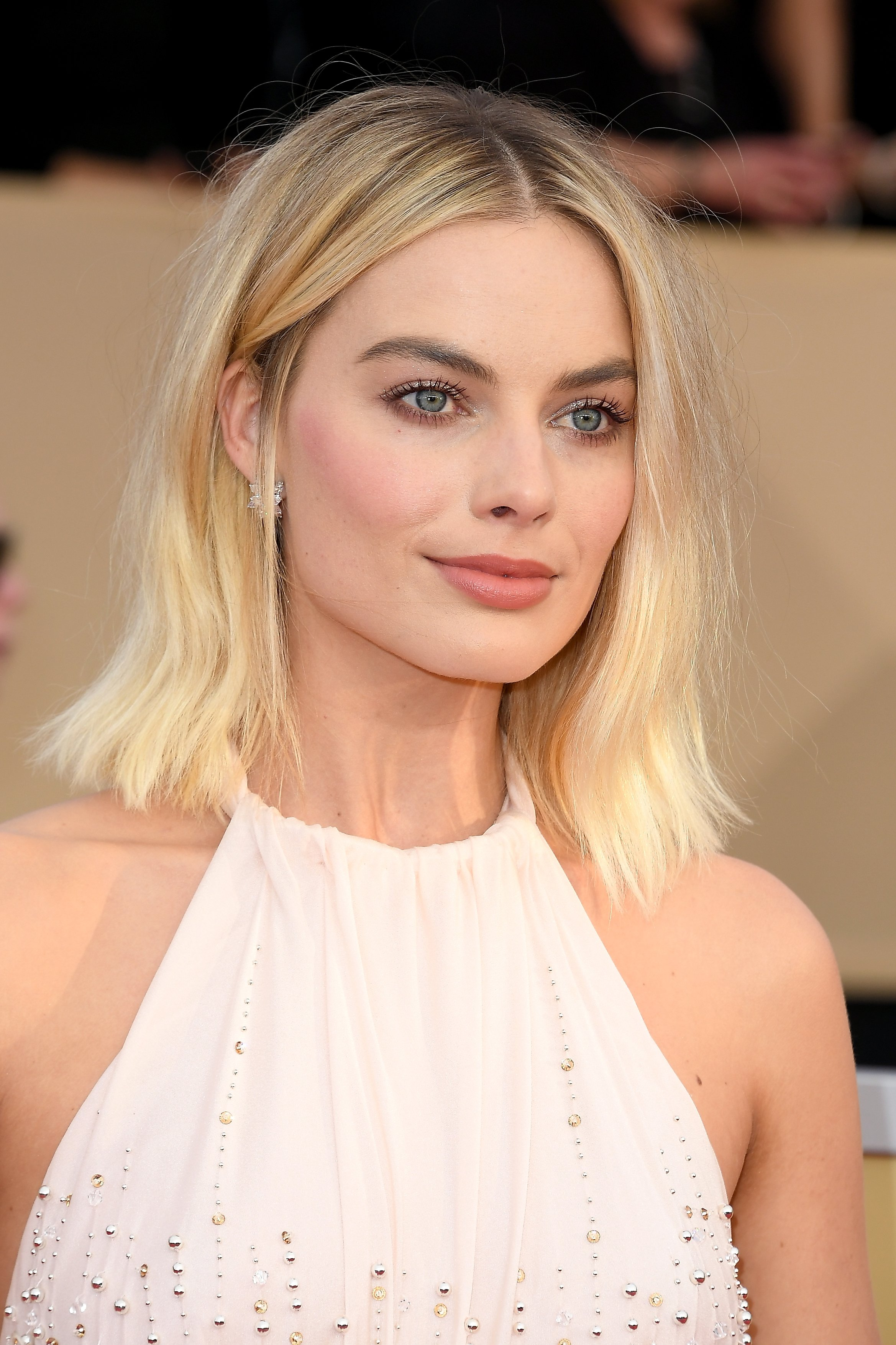 Margot Robbie attends the 24th Annual Screen Actors Guild Awards with hair by Moroccanoil Celebrity Hairstylist Bryce Scarlett. Photo Credit: Steve Granitz Steve Granitz