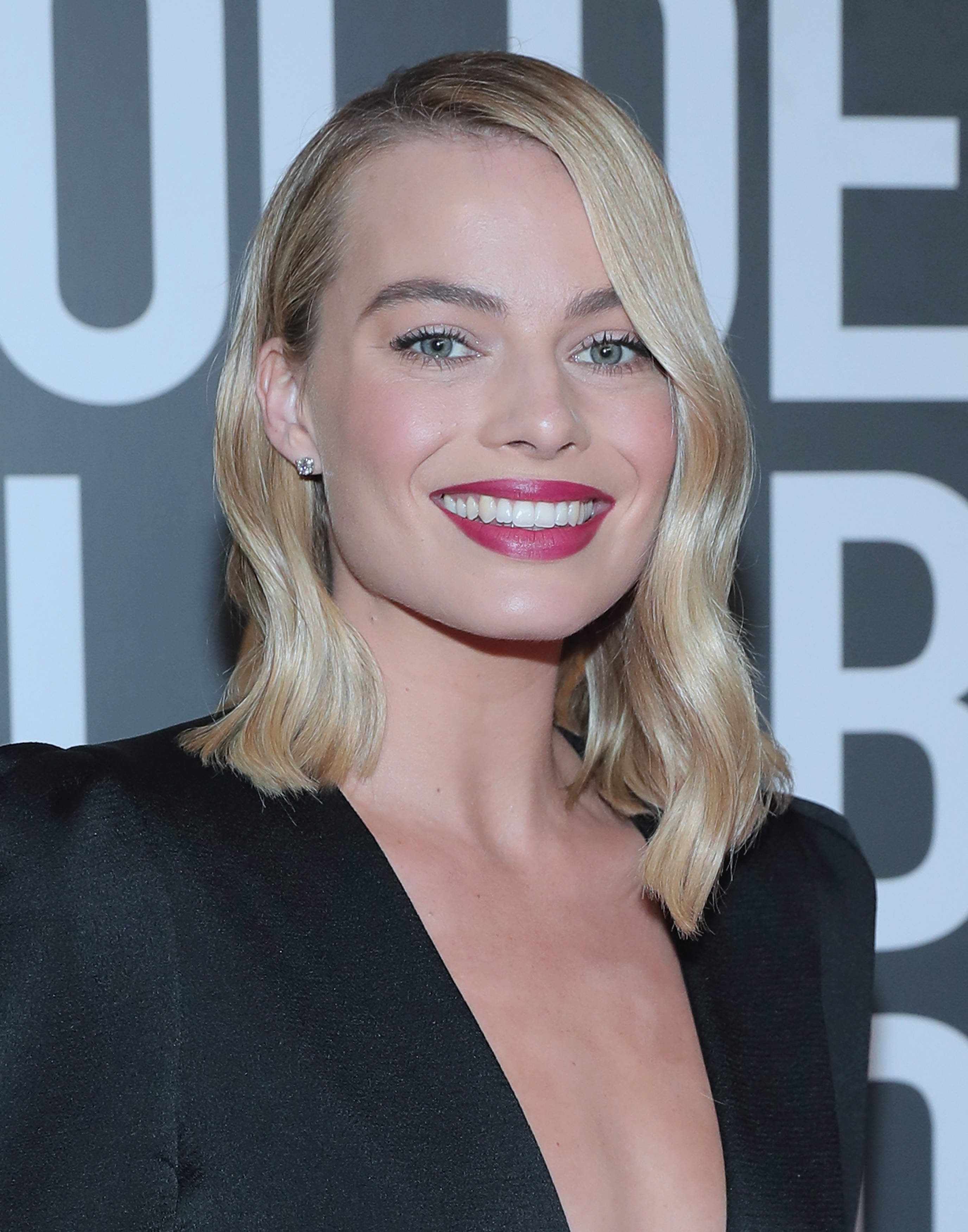 TEAM EFFORT: Margot Robbie at the 75th annual Golden Globe Awards with color by Tracey Cunningham and style by Bryce Scarlett.