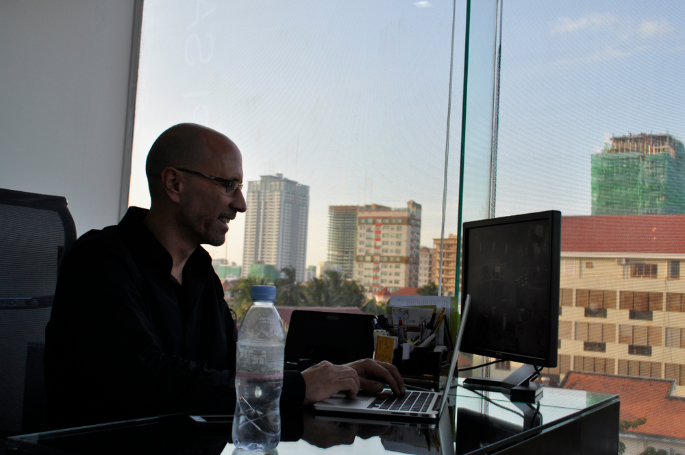 Fairfax in his office in Phnom Penh. His dream is to have a number of Kate Korpi salons and training academies.