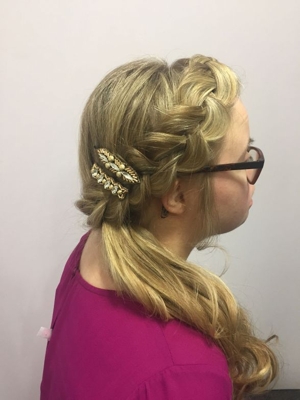 """For Michelle's hairstyle, Waligora created a side boho-style side braid that came into loose curls. She added Pink Pewter's <a href=""""http://www.pinkpewter.com/Pink_Pewter_Collection_Tatianna_Bobby_Pins_p/tatianna.htm"""" target=""""_blank"""" rel=""""noopener"""">Tatiana bobby pins</a> for extra sparkle and glam."""