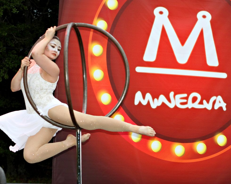 <p>An ariel acrobat was one of dozens of circus artists gracing the stage at the Minerva party.</p>