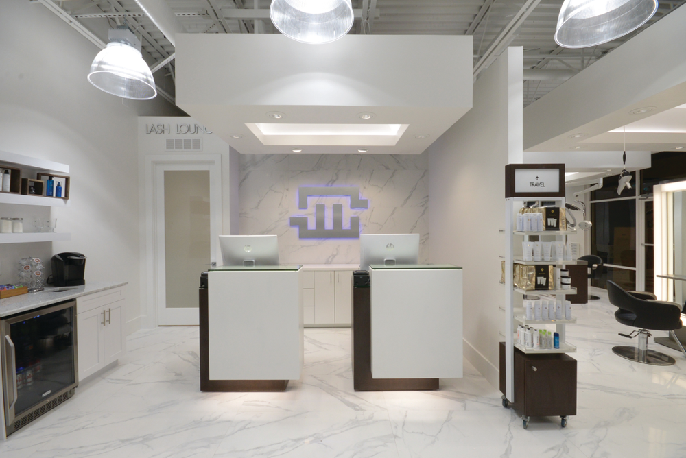 "<a href=""https://www.monacosalon.com/contact/monaco-hair-extensions-lounge-tampa/"" target=""_blank"" rel=""noopener"">Monaco Salon Extension Lounge</a> in Tampa, Florida, was looking to create a design that was sleek. The marble flooring and wall accents instantly bring the salon up a level in class. The marble is accented further with the salon's branded logo, which has been backlit in blue."