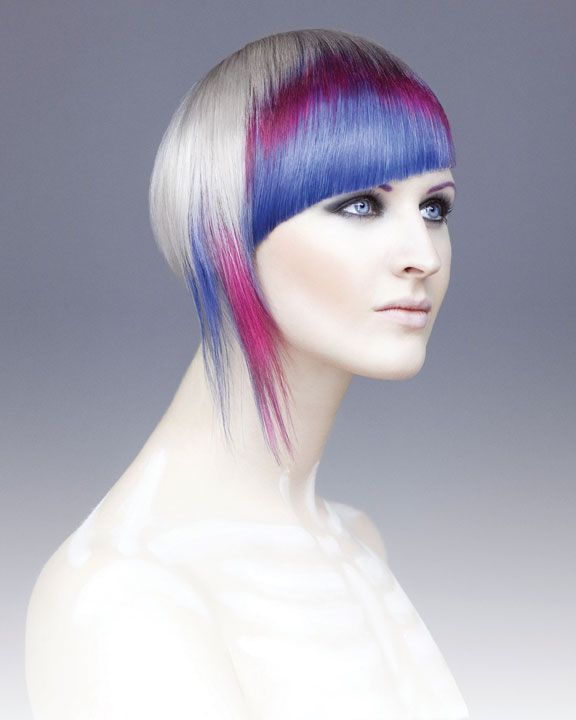 pale & purple - Moreno used Vero K-PAK Color Crème Lightener to lift the model's strands to icy platinum. Then he created diagonal sections in the fringe area, and alternated slices of dark blue, light blue, soft magenta and pink.