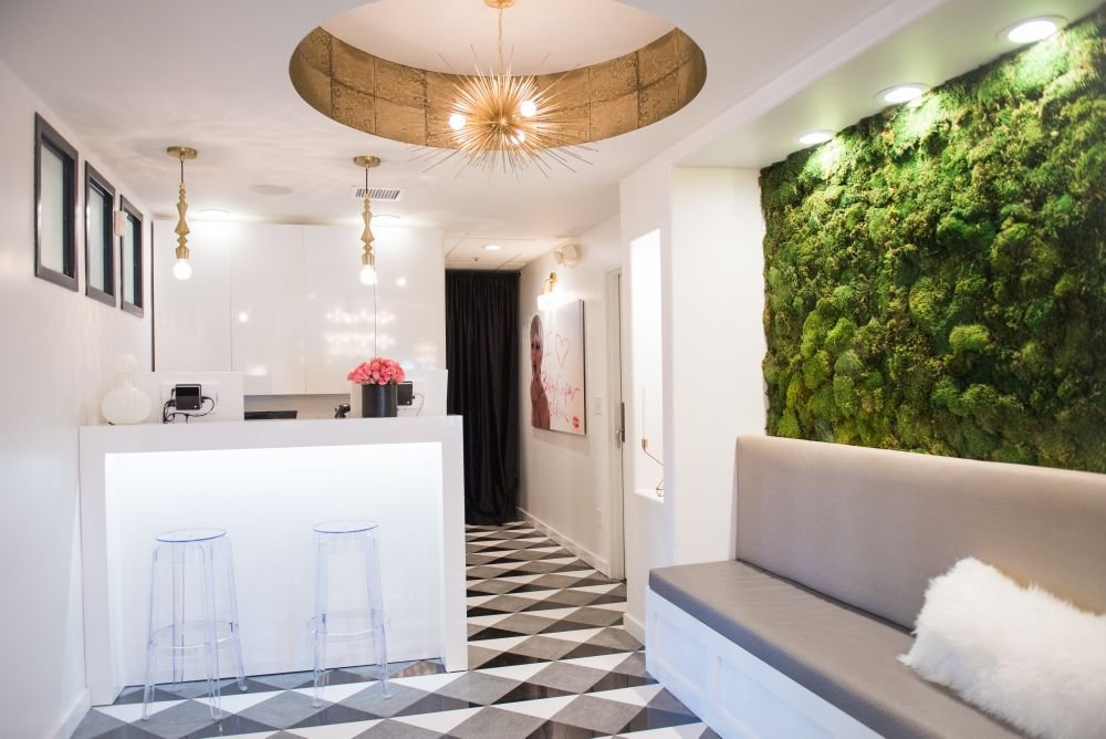 A living moss wall, art deco-tiled floor and a whimsical chadelier lifts the moods of guests no matter what dreary weather awaits them outside.
