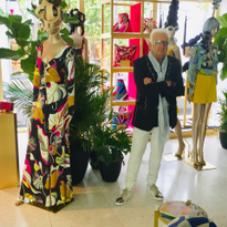 Nicholas French in the Miami Boutique of Emilio Pucci surrounded by the hair he created for the...