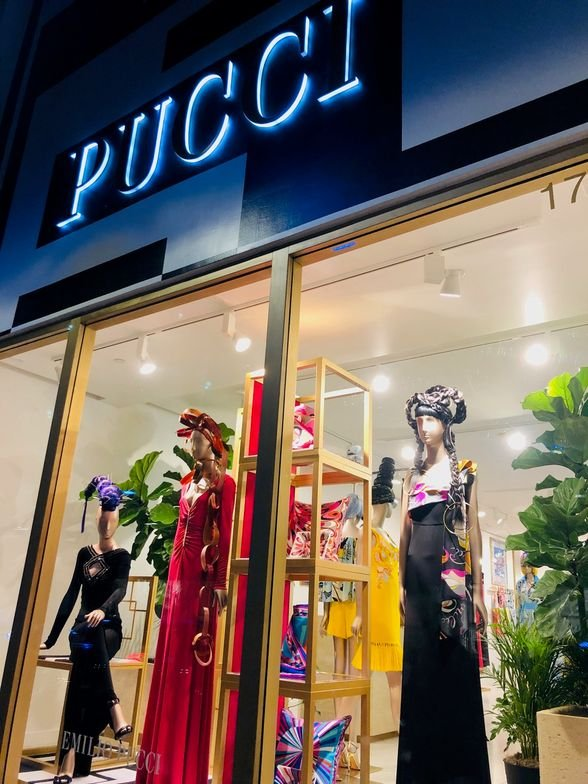 Nicholas French hair design enhancing the mannequin for the Resort 2019 Collection in the Miami Boutique of <strong>Emilio Pucci - as seen from the street.</strong>