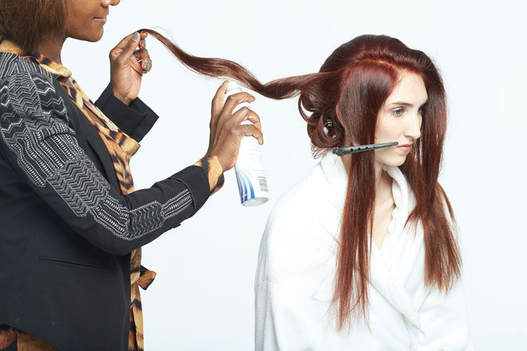 3. Take 2-inch sections and wrap around a mediumbarrel curling iron.