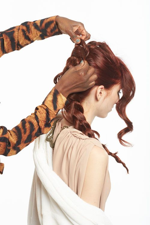 7. Return to the braid and pull out and up to add a natural, random texture.