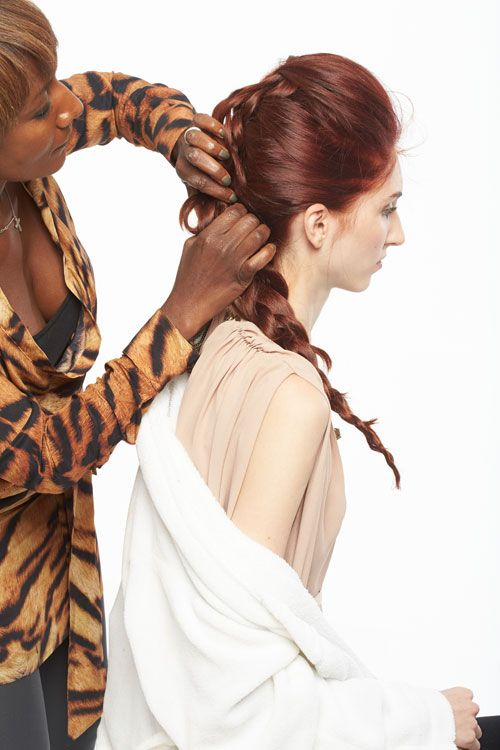 9. Direct back over the existing braid and create a new braid from the top of the crown. Tuck ends into the existing braid and secure with pins.