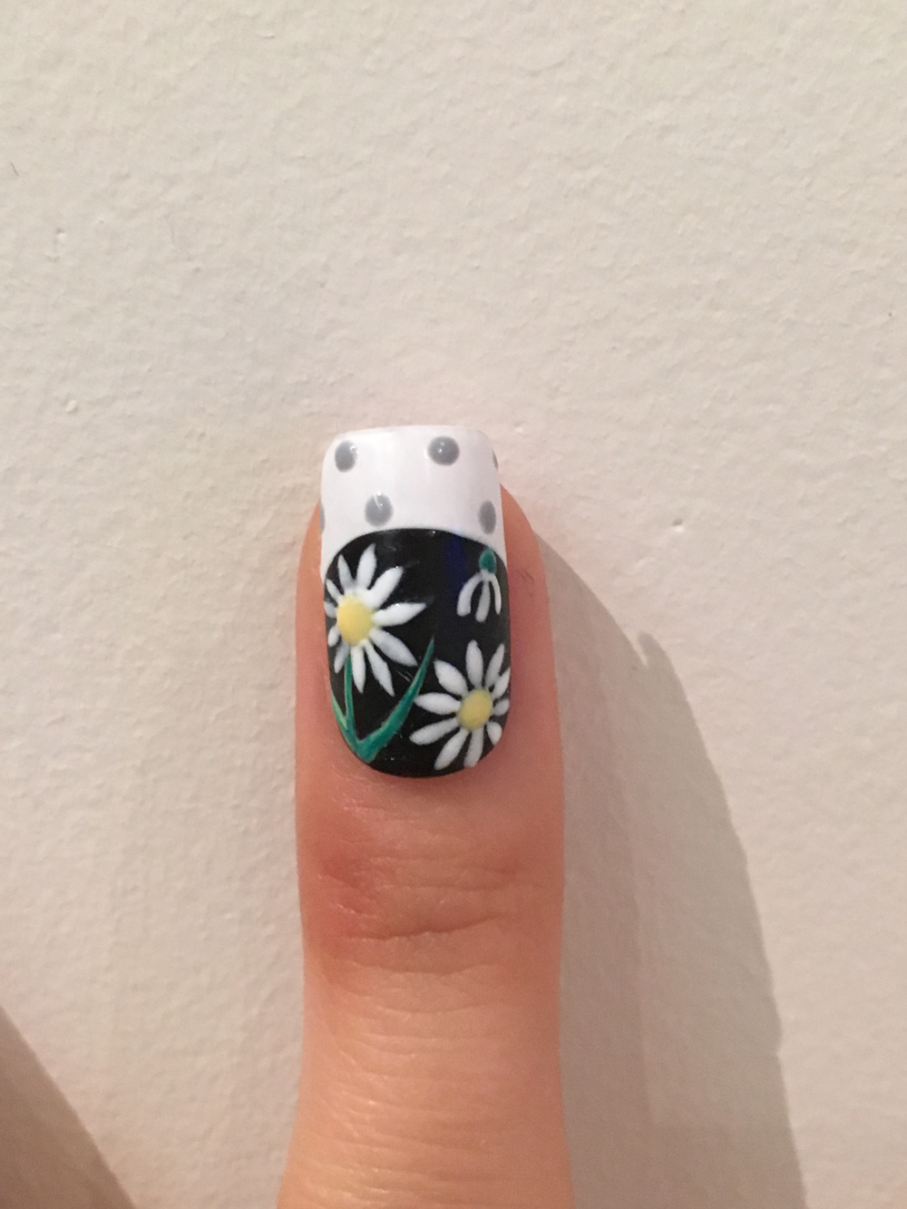Add petals around yellow dots. Then add leaves. Draw gray dots on tip.