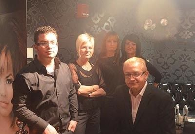 Celebrity hair stylist Naz Kupelian (seated) and his team with their pop-up Beauty Lounge.