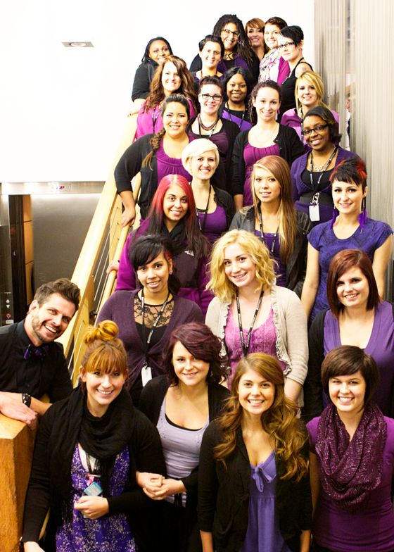 Dressed in purple, students at Neroli's Institute of Beauty and Wellness prepare for CUT IT OUT day.