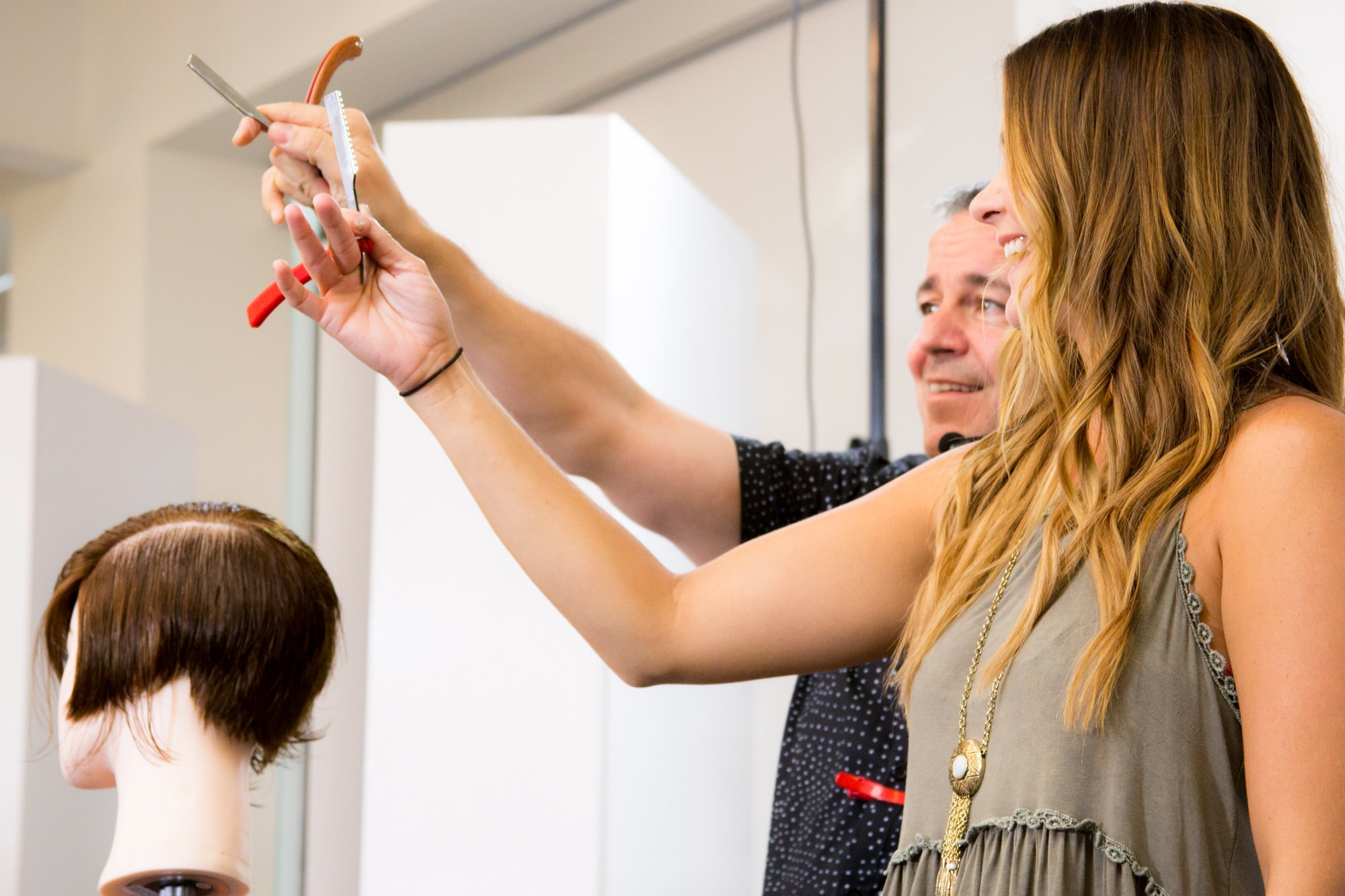 During an educational event at Club Intrigue, Nick Arrojo launched a Learn Together segment, inviting up one volunteer for a razor-cutting demonstration.