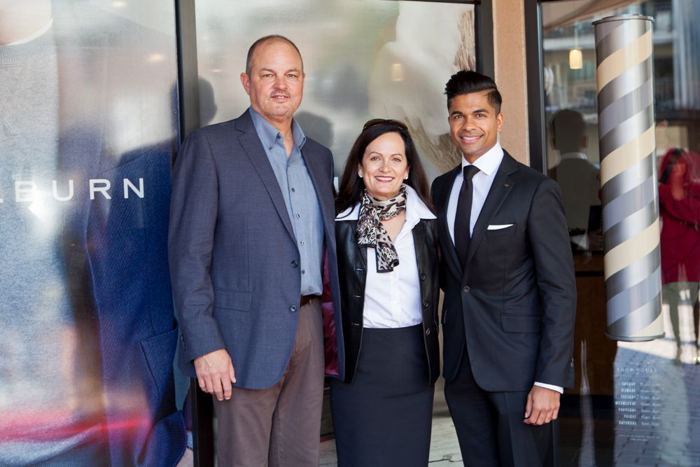 Weldon Barber's Bill and Suzette Nordstrom with J.Hilburn's Veeral Rathod, on the opening day of the new location.
