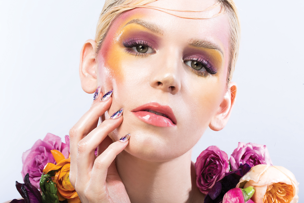 Crowe painted a splatterpaint-inspired design on the nails with Essie polish.