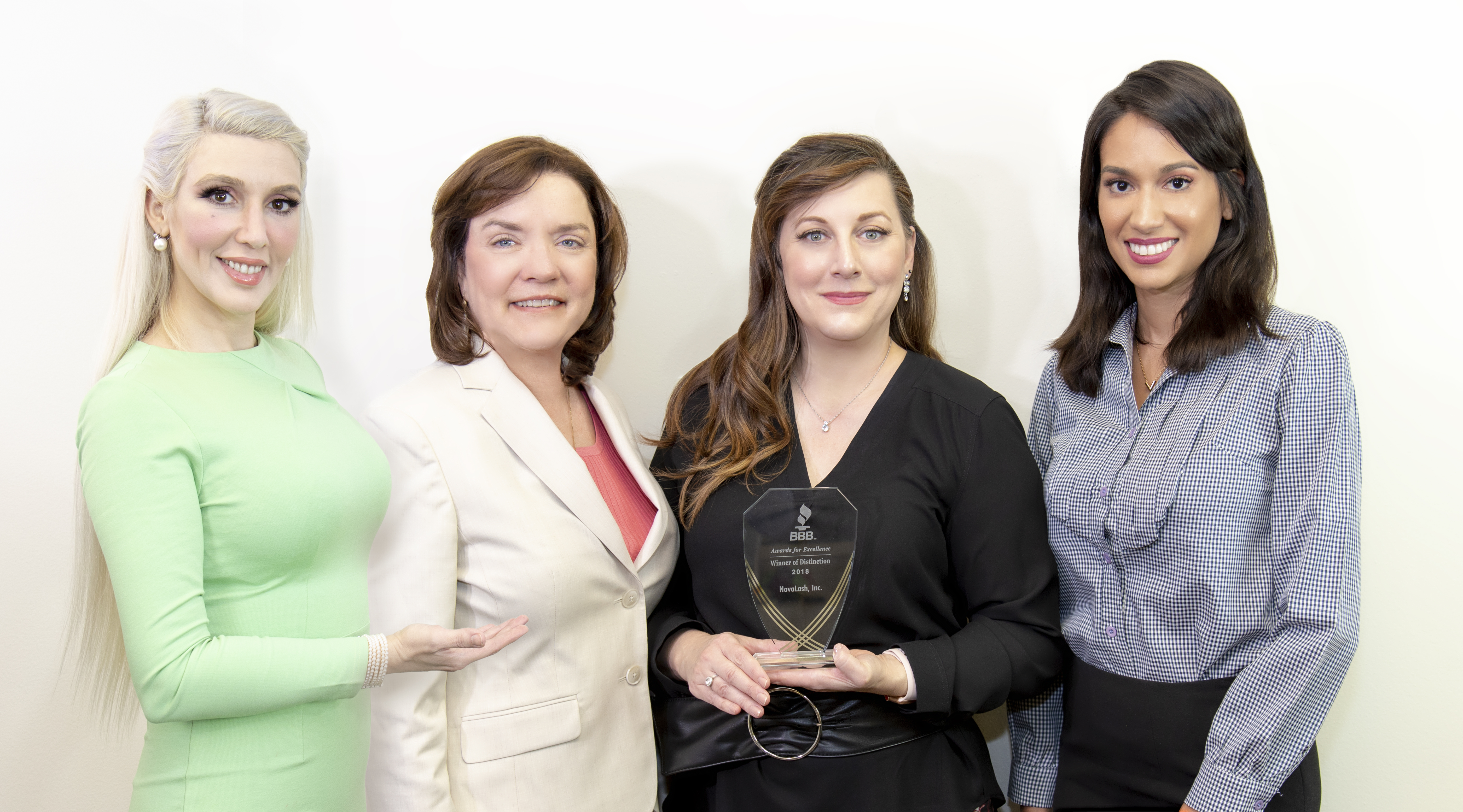 Team NovaLash accepts The Better Business Bureau's Distinction Award, celebrating a commitment to excellence and quality. Left to right: Sophy Merszei, CEO, NovaLash, Beth Fetzer, NovaLash COO, Cami Mullins, NovaLash Sales Manager, Vanessa Max, NovaLash Project Coordinator.