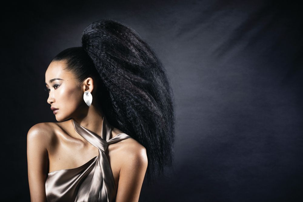 "<p>""With thick hair it's important to use a brush that molds as oppose to straightens,"" Elias says. ""Asian hair already has weight, which can make it fall, so don't focus too much on volume, focus on shape using a brush that compacts the cuticle but has enough grip to mold the hair.""</p> <p>Using the Olivia Garden Supreme Combo brush, blow dry damp hair and begin molding it up. Create a ponytail and secure. Crimp all hair in the ponytail. Take small sections and smooth with the Fingerbrush Combo. Using the CarboSilk comb, take 1/2-inch sections of ponytail and tease. Smooth the perimeter with the Supreme Combo brush. Set with a workable spray.</p>"