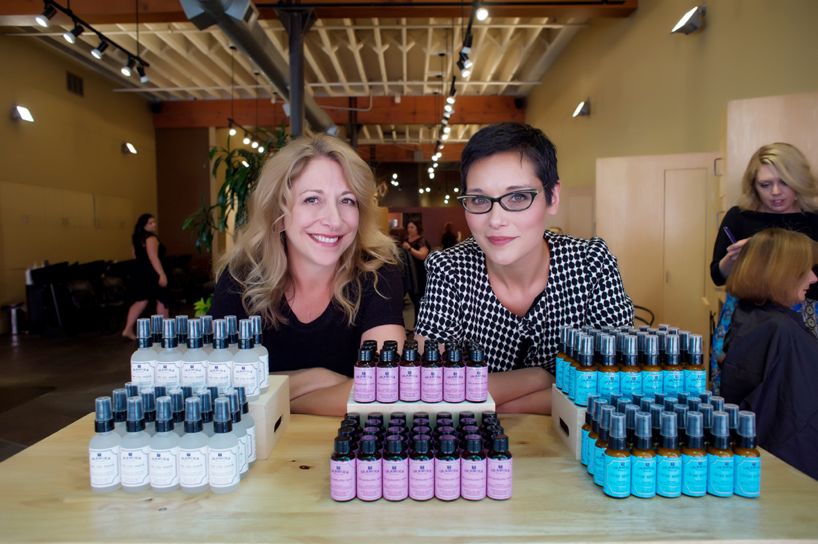 Daria Daniel, owner of Portland, Oregon's Urbaca Salon and Sherry Okamura, the salon's digital director and the founder of Okamura Farmacopia, a line of products inspired by the salon's stylists. (photo credit: Crystal Genes Photography) Crystal Genes Photography
