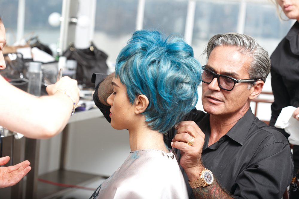 Oribe works on a wig fitting on-set at a MODERN SALON cover shoot.