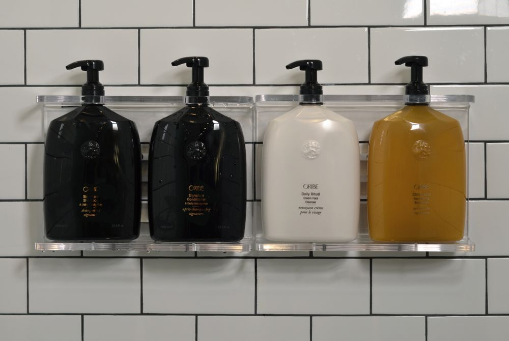 Left to Right: Liter-sized versions ofSignature Shampoo, Signature Conditioner,Daily Ritual Cream Face Cleanser andReplenishing Body Wash.