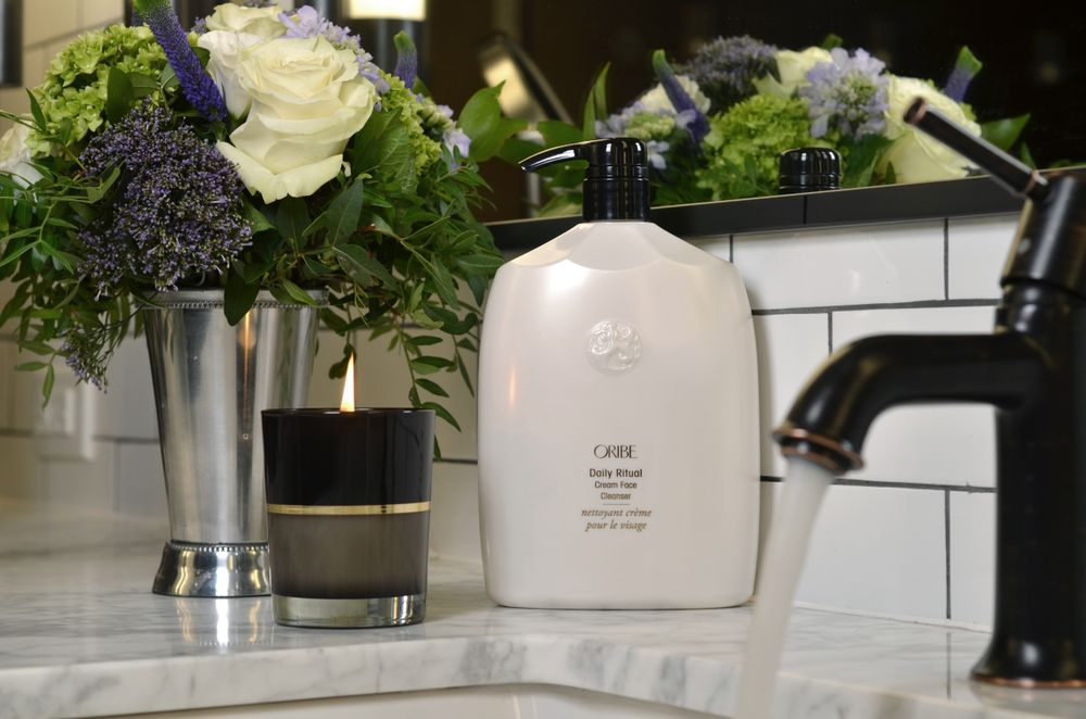 Oribe's Liter-sized Daily Ritual Cream Face Cleanser andCôte d'Azur Candle.