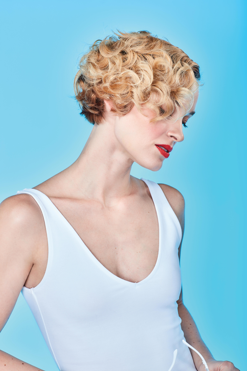 "<p>This classic arching bob has very slight graduation on top layers of hair. ""We reinvented this classic shape through styling to give a 30s-40s inspired look,"" Cutler says. ""Using 3/4"" iron, we over-directed hair to create flatness at part line, then brushing out curls.""</p> <p>Key product used: Cibu Texture Addict Dry Wax Spray</p>"