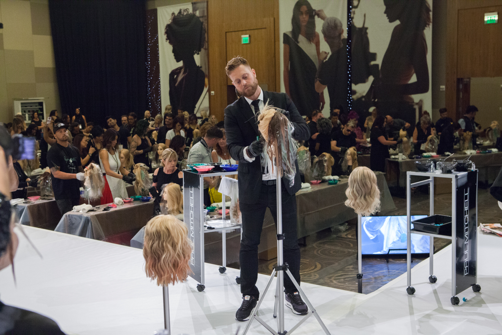 <p><em>Artistic Director of Color, Colin Caruso, taught on platform and shared innovative formulations using Paul Mitchell Professional Color.</em></p>
