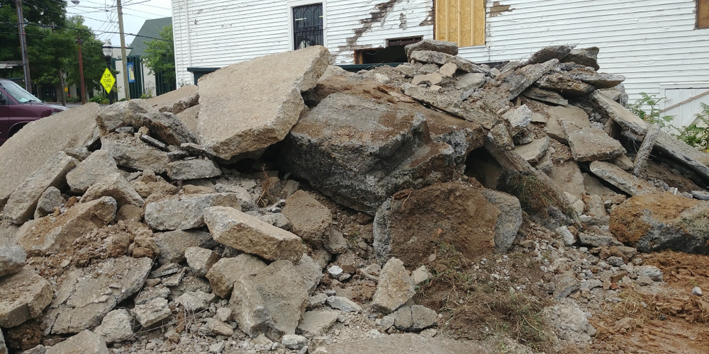 The building's original parking space only had room for four cars. When the contractor dug it up to expand it, they found the foundation of another former building beneath it.