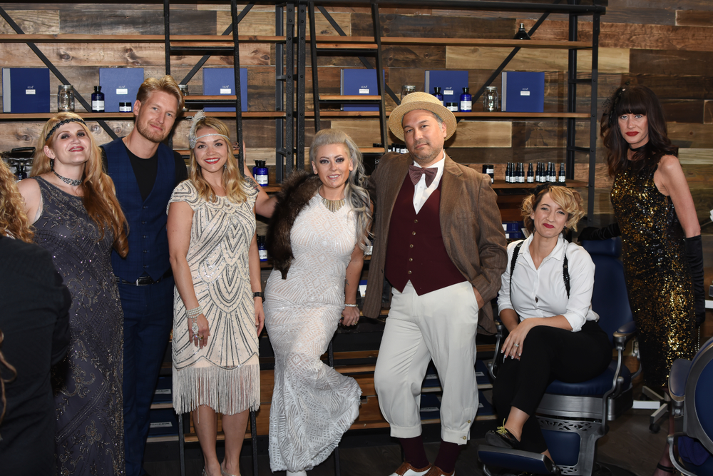 Celebrants in appropriate era-styled fashions attend the opening celebration at the 1922 Men's Grooming Salon.
